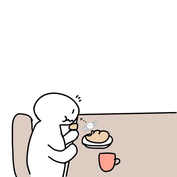 朝ごはんを食べる人間を見ている時計